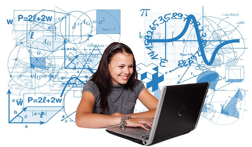girl doing math on laptop